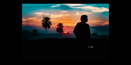 Thinking person in sunset